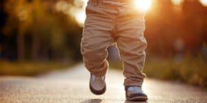 Child walking on sidewalk