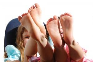 Two little girls playing with feet in the air, Pediatric Foot & Ankle, Gilbert AZ