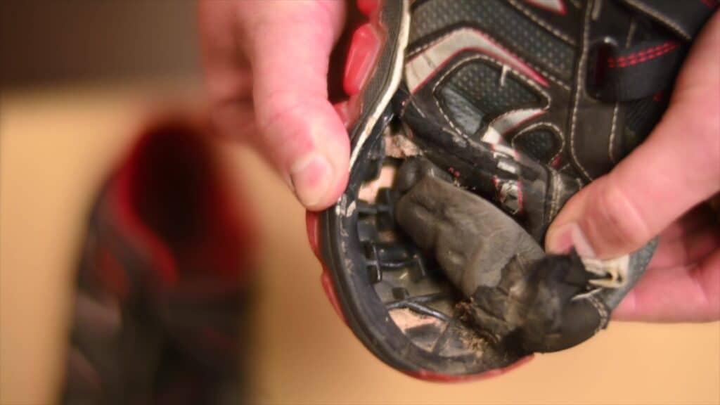 Dr. Jarman showing a worn out shoe