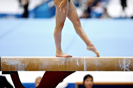 young gymnast on balance beam heel pain severs disease